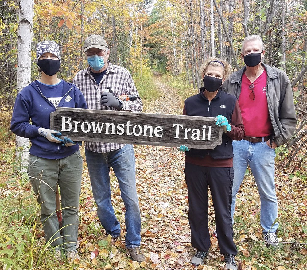 Conservation Manager Erika Lang with volunteers Rex Dollinger and Suz and Bryce Thomson